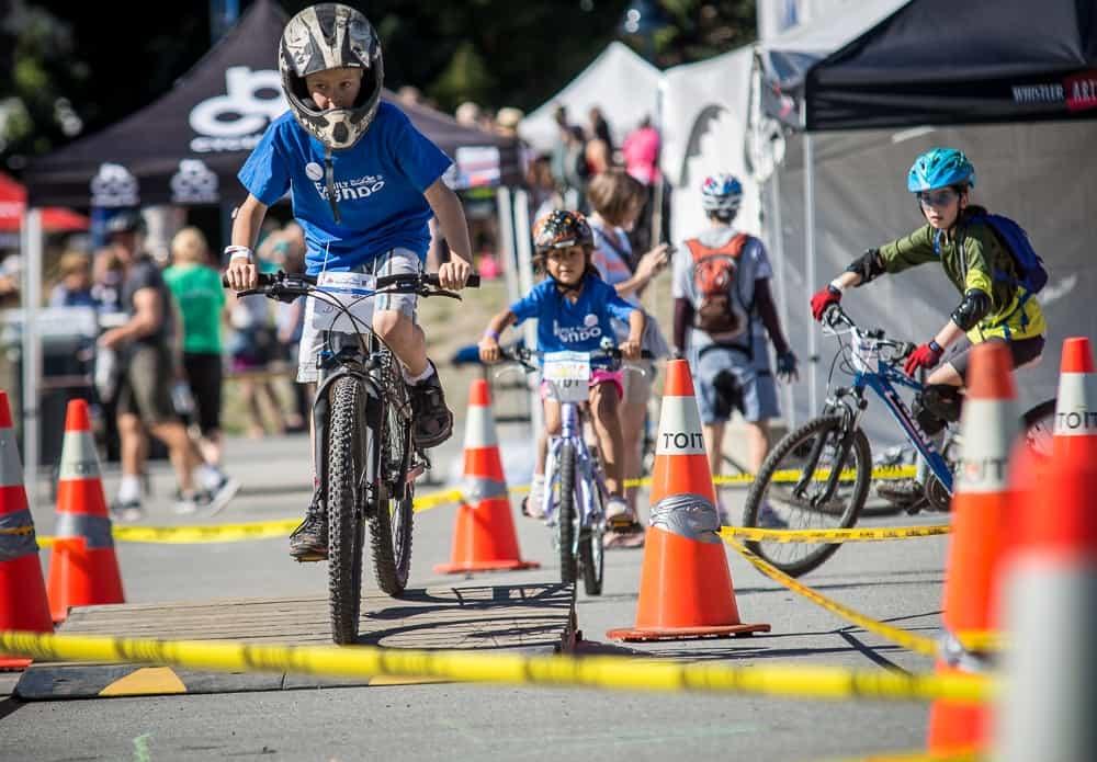 Kids riding bikes in the kids bike zone at the RBC GranFondo Whistler
