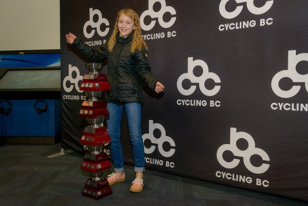 Geza Rodgers and her multiple trophies at the Cycling BC Season Wrap-up Party. Photo credit: Rob Shaer