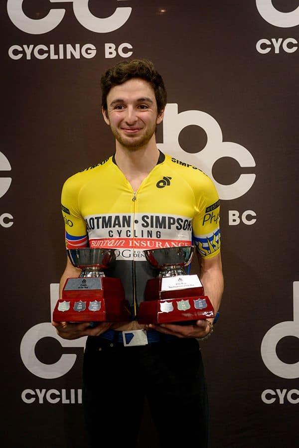 Alex Amiri holding Cycling BC trophy