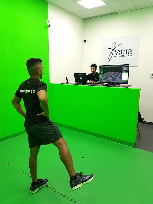 Man in 3-D motion capture room raising right leg to the side.