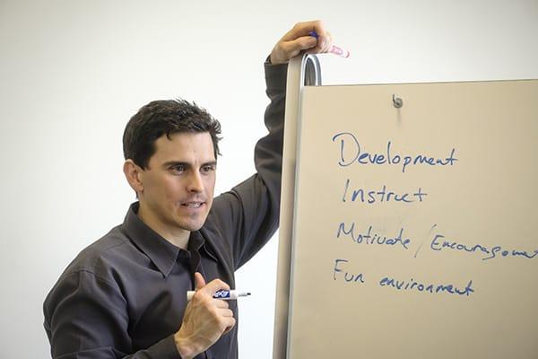 Ben Chaddock writing on a white board