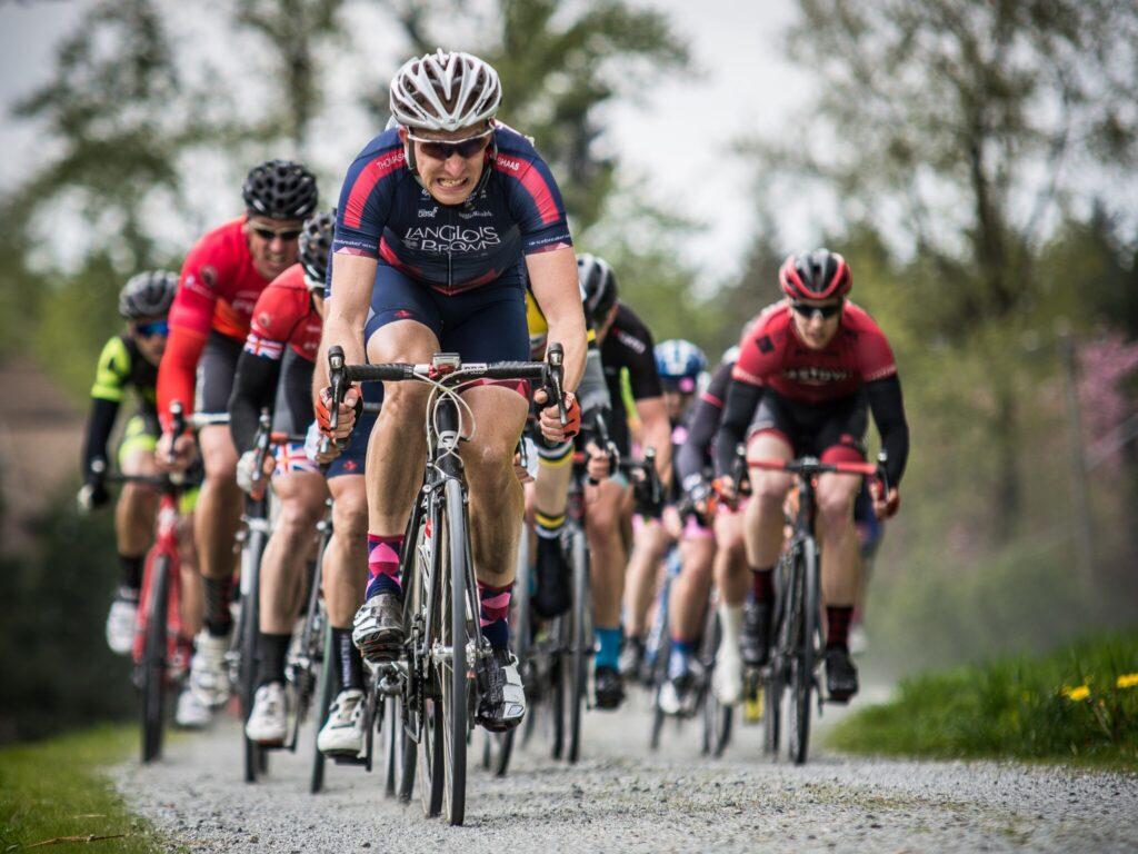Peloton riding on gravel road