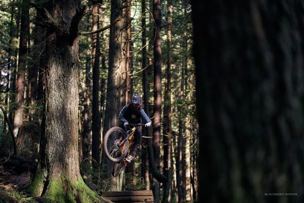 Female mountain biker catching some air