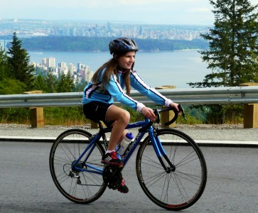 Girl on Bike With Vancouver